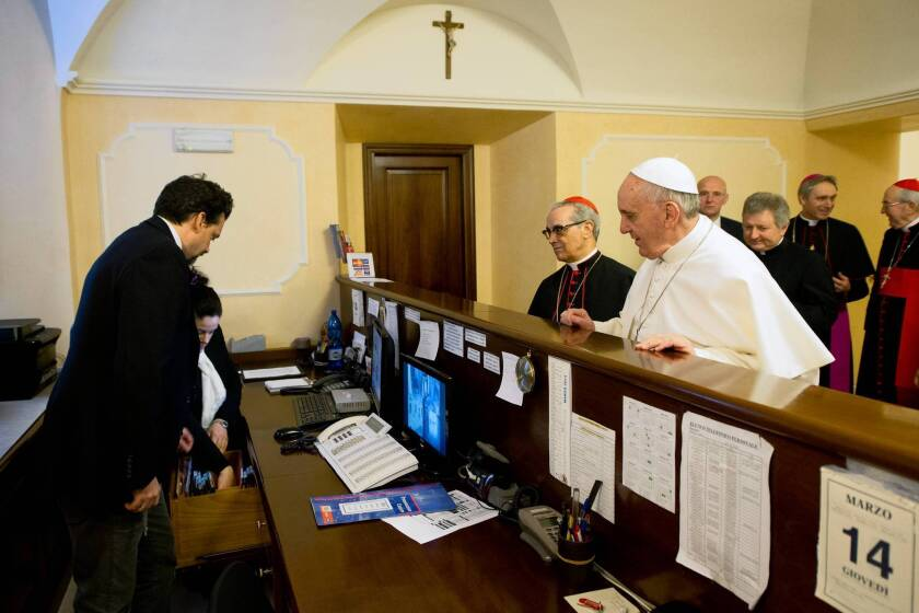 Pope Francis takes Vatican trappings to a new plain