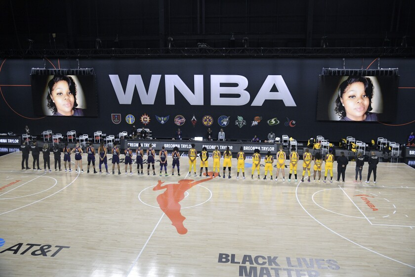 Players from the Sparks and Phoenix Mercury stand for a moment of silence in honor of Breonna Taylor on July 25.