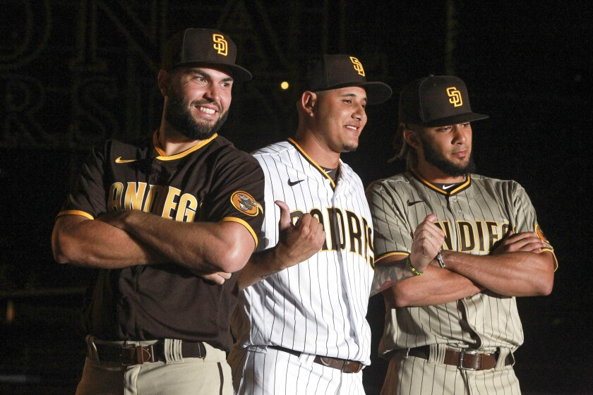 The Padres' Eric Hosmer, Manny Machado, and Fernando Tatis Jr. present their new uniforms in the fall of 2019.