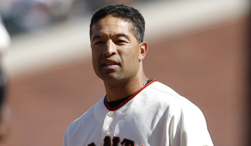 Former San Francisco Giants outfielder Dave Roberts takes the field against the San Diego Padres during an opening day game against on April 7, 2008.