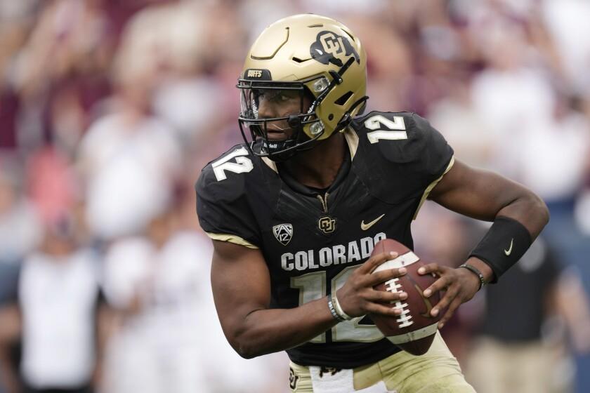 Colorado quarterback Brendon Lewis runs for a short gain in the second half of an NCAA college football game against Texas A&M, Saturday, Sept. 11, 2021, in Denver. Texas A&M won 10-7. (AP Photo/David Zalubowski)