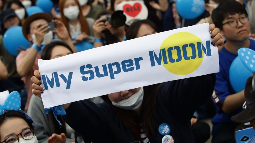 Supporters of South Korean presidential candidate Moon Jae-in of the Democratic Party of Korea, chee