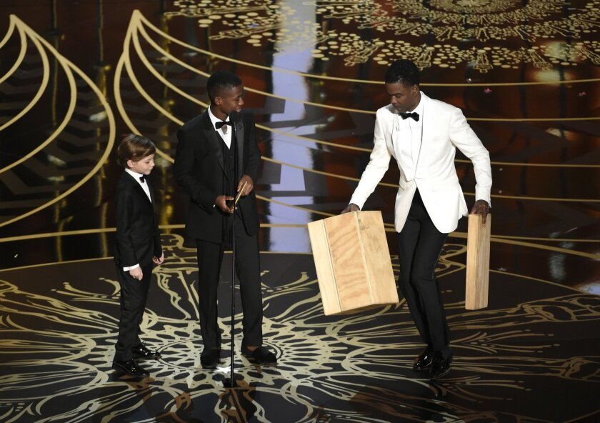 Jacob Tremblay, from left, Abraham Attah, and Chris Rock present the award for best live action short film at the Oscars on Sunday, Feb. 28, 2016, at the Dolby Theatre in Los Angeles. (Photo by Chris Pizzello/Invision/AP)