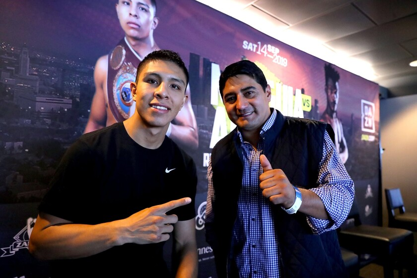 WBO junior middleweight champion Jaime Munguia, left, hired Hall of Fame boxer Erik Morales as his trainer going into this weekend's fight against Patrick Allotey in Carson.
