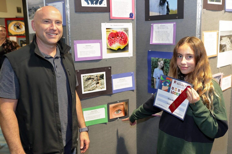 "Mark and Alyssa Holley with Alyssa's artwork ""Gateway to the Soul."" Alyssa attends Earl Warren Middle School"
