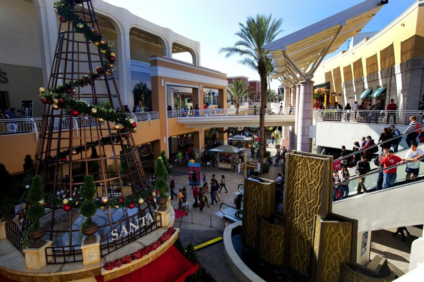 Holiday shoppers took advantage of Black Friday sales at Fashion Valley shopping Center last year. This year, consumers will be on the lookout for even better deals as they respond to economic uncertainty by trimming their budgets.