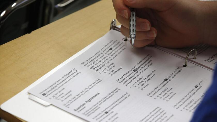 A student looks at questions during a college test preparation class at Holton-Arms School in Bethesda, Md.