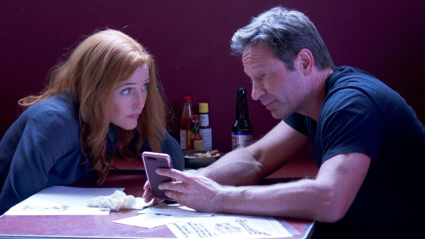 """Gillian Anderson and David Duchovny as agents Dana Scully and Fox Mulder in the 11th season of Fox's """"The X-Files."""""""