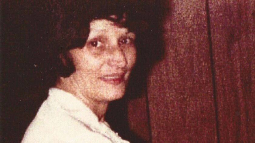 A photo of Helen Roscoe with one of her children. She was robbed and stabbed to death in 1989 in Ch