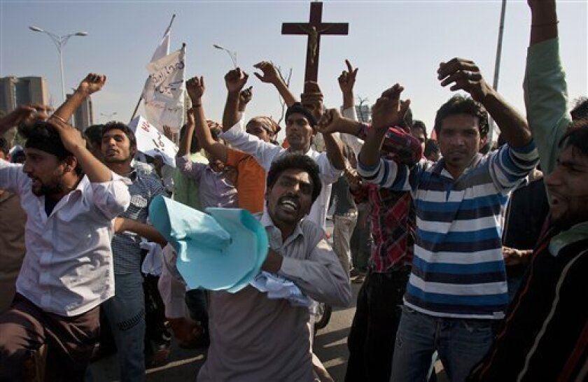 Pakistani Christians chant slogans during a demonstration demanding that the government rebuild their homes after they were burned down following an alleged blasphemy incident, in Islamabad, Pakistan, Sunday, March 10, 2013. The incident in Lahore began on Friday, March 8, 2013 after a Muslim accus