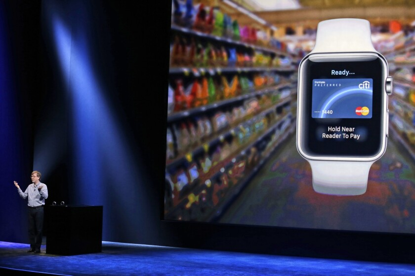 Apple's Kevin Lynch discusses the Apple Pay feature of the new Apple Watch in March.
