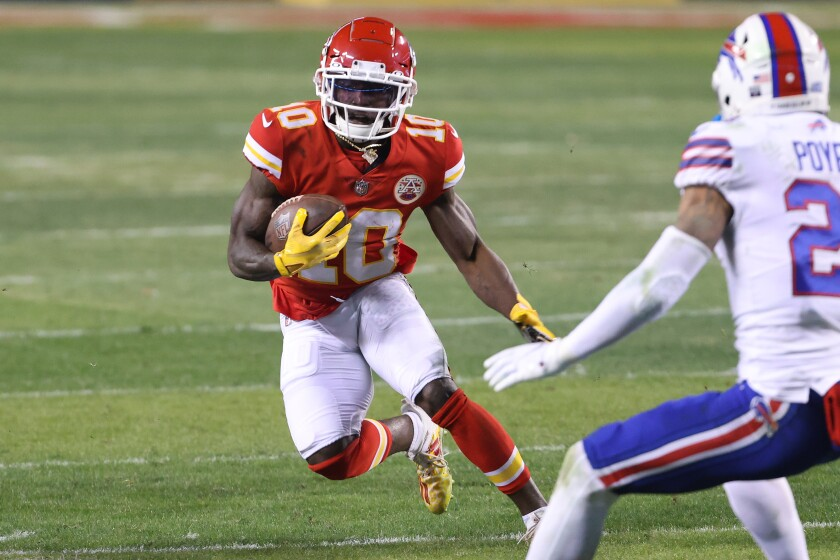 Tyreek Hill of the Kansas City Chiefs runs with the ball during AFC Championship Game on Sunday against Buffalo.