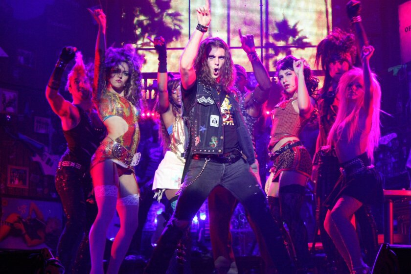 "Dominique Scott (center) and the cast of the musical ""Rock of Ages,"" now playing at the San Diego Civic Theatre."
