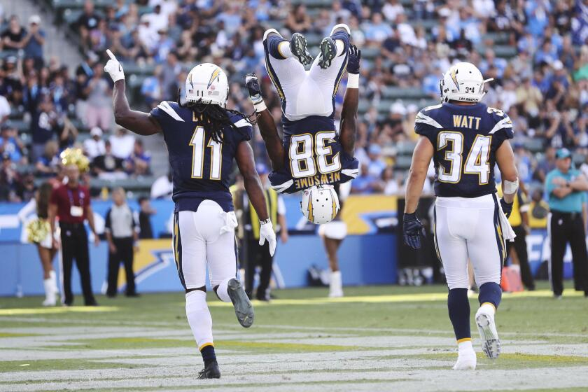 Los Angeles Chargers running back Detrez Newsome (C) does a flip in celebration of his touchdown as Los Angeles Chargers wide receiver Geremy Davis (L) and Los Angeles Chargers fullback Derek Watt (R) join him for the celebration during the NFL American Football game between the New Orleans Saints and Los Angeles Chargers at the StubHub Center in Carson, California, USA, 25 August 2018.