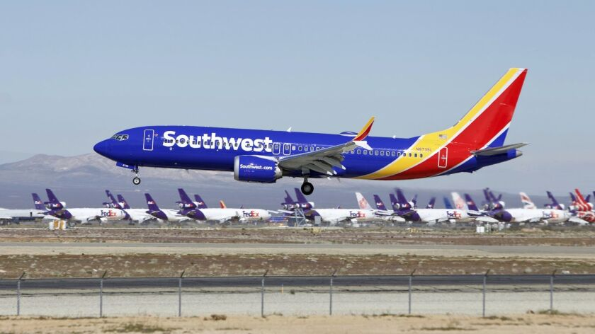 A Southwest Airlines Boeing 737 Max aircraft lands at Southern California Logistics Airport in Victorville on March 23.