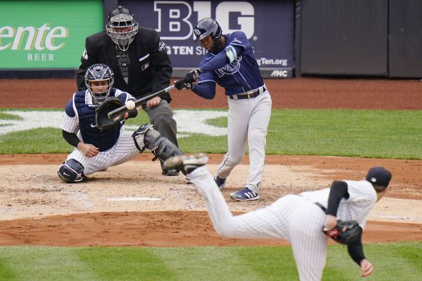 Tampa Bay Rays' Manuel Margot hits a two-run home run during the fourth inning of a baseball game against the New York Yankees, Saturday, April 17, 2021, in New York.(AP Photo/Frank Franklin II)