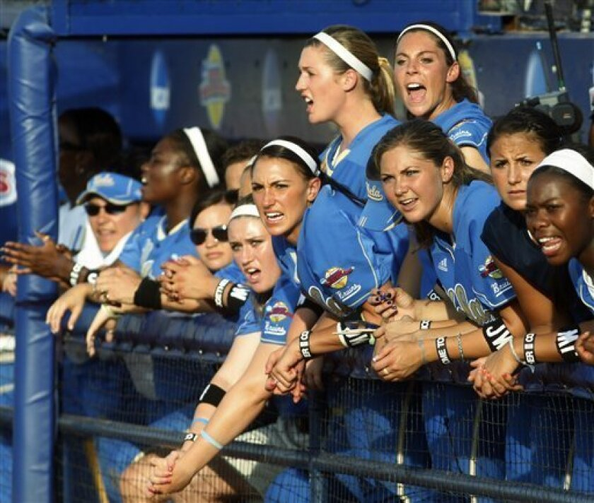 UCLA players cheer in the dugout during the first inning of the second game of a best of three championship series game against Arizona in the NCAA Women's College World Series finals, in Oklahoma City, Tuesday, June 8, 2010. UCLA won the first game 6-5. (AP Photo/Sue Ogrocki)