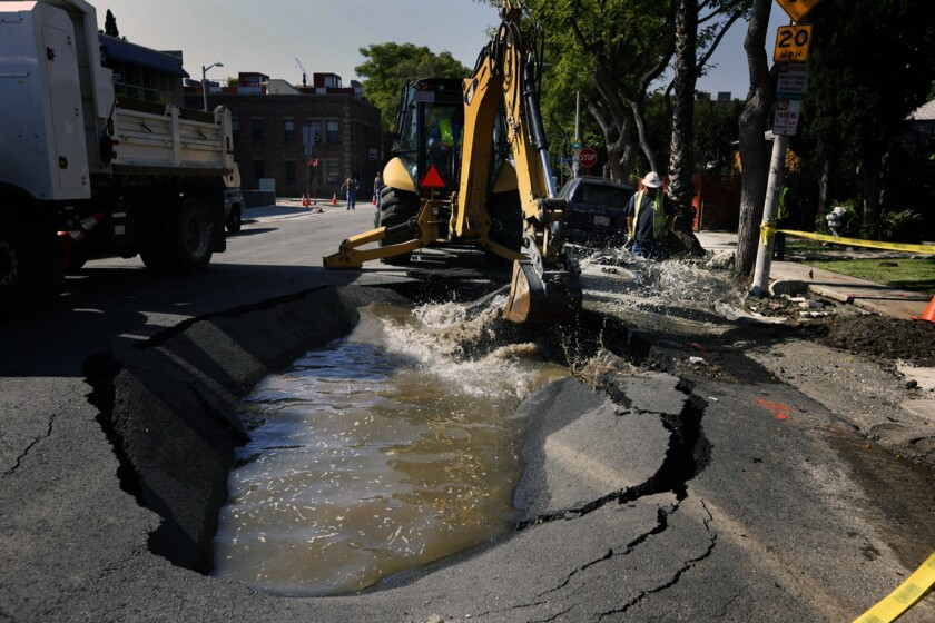 DWP workers repair a sinkhole on Formosa Avenue in West Hollywood that was caused by a water main break.