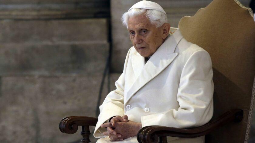 A Dec. 8, 2015, photo of Pope Emeritus Benedict XVI in St. Peter's Basilica at the Vatican.