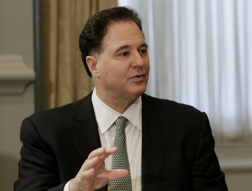 FILE - In this Dec. 2, 2010, file photo, Steve Pagliuca, managing director of Bain Capital, speaks during a conference at the New York Stock Exchange in New York. The group leading the bid to bring the 2024 Olympics to Boston shook up its management Thursday, May 21, 2015, making Boston Celtics co-owner Pagliuca the new chairman in an attempt to revive the city's chances of hosting the Summer Games. Pagliuca takes over the effort to convince the IOC to send the Summer Olympics to the United States for the first time since 1996. (AP Photo/Richard Drew, File)