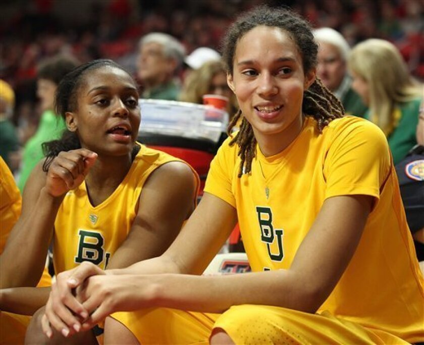 Baylor's Brittney Griner, right, laughs with Brooklyn Pope during the final moments of their 90-60 win over Texas Tech in an NCAA college basketball game in Lubbock, Texas, Wednesday, Jan. 30, 2013. (AP Photo/Zach Long)