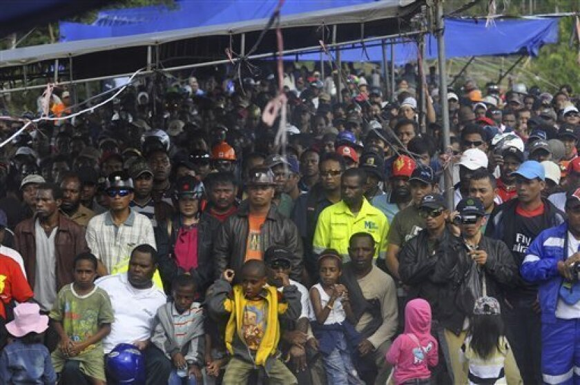 In this Sunday, July 10, 2011 photo, workers of global mining giant Freeport-McMoran gather during a strike in Timika, Papua province, Indonesia. Thousands of workers are currently on a strike at the gold and copper mine in eastern Indonesia to demand higher wages and protesting the dismissal of their six union leaders. (AP Photo)