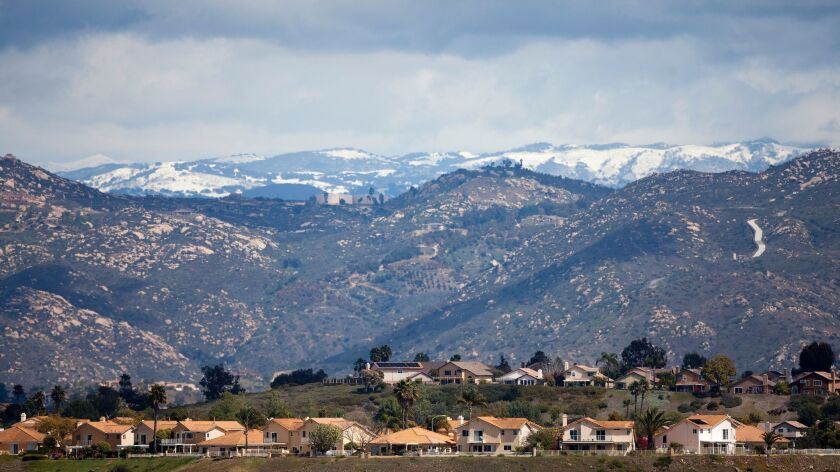 March 19, 2012_San Diego, California_USA_ Snow on Vulcan Mountain over the houses on Camino Codorniz