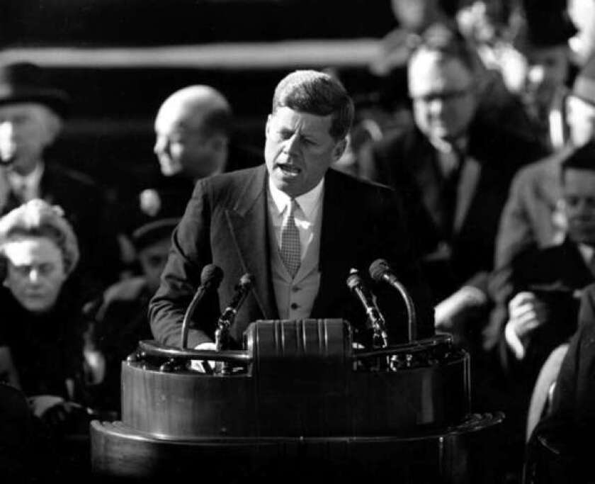 """President John F. Kennedy delivers his inaugural address after taking the oath of office at Capitol Hill in Washington, D.C., on Jan. 20, 1961. JFK said: """"Ask not what your country can do for you."""""""