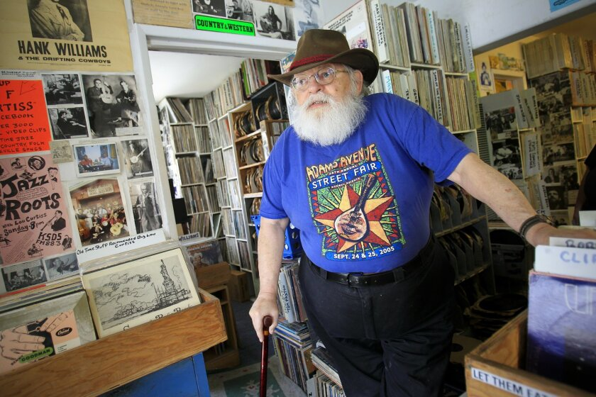 Lou Curtiss in his semi-legendary store, North Park's Folk Arts Rare Records, which he and his wife, Virginia, own. The store is closing at the end of June; a new owner plans to re-open Folk Arts at a new location in September. Curtiss has been a key mentor to many present and past San Diego perfor