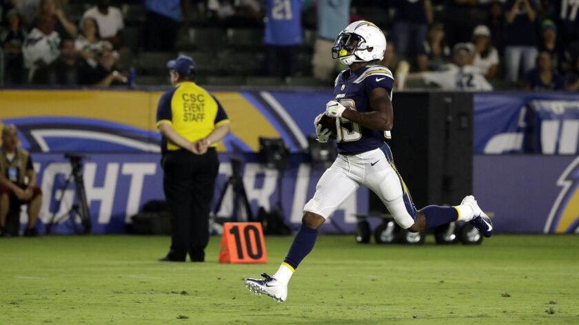 Chargers wide receiver JJ Jones returns a punt for a touchdown against the Seattle Seahawks.