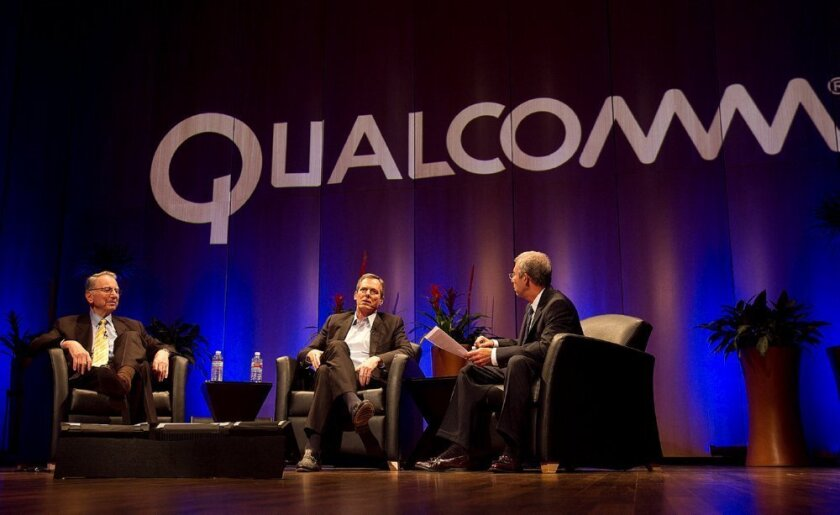 Qualcomm founder Irwin Jacobs (left) and CEO Paul Jacobs (center) discuss the 25-year history of the company with a moderator Wednesday at Qualcomm headquarters in Sorrento Valley.