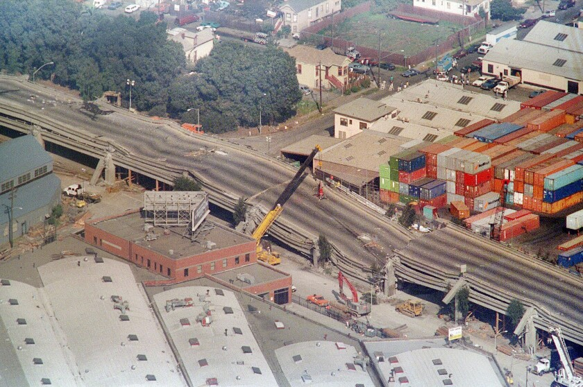 Cranes surround the Cypress Structure on Interstate 880 in Oakland after the 1989 temblor.