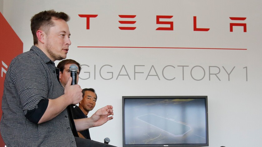 Elon Musk speaks at the recent grand opening of Tesla's Gigafactory 1. The Nevada battery production facility is still under construction.