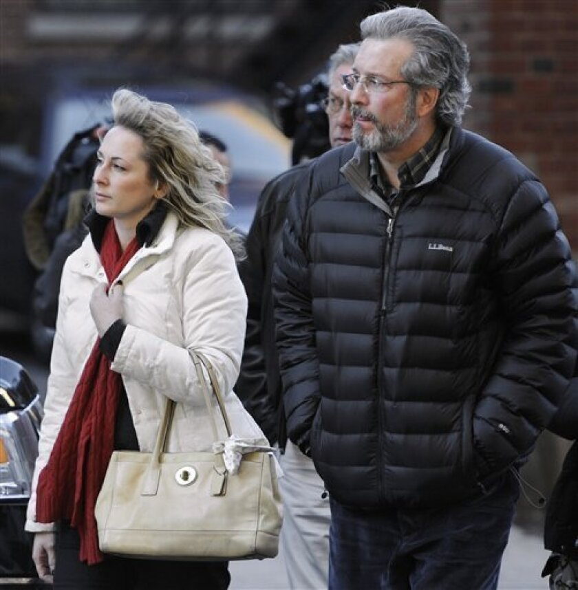 FILE - In this Thursday Dec. 8, 2011 file photo, Dr. William Petit Jr., right, arrives at Superior Court in New Haven with friend Christine Paluf, left, on the fourth day of jury deliberations for the penalty phase of the trial of Joshua Komisarjevsky in New Haven, Conn. Petit, the sole survivor of the 2007 Cheshire, Conn., home invasion where his wife, Jennifer Hawke-Petit and their daughters, Hayley and Michaela, were murdered, became engaged over the weekend to Paluf according to a family friend, Wednesday, Jan. 4, 2012. (AP Photo/Jessica Hill, File)