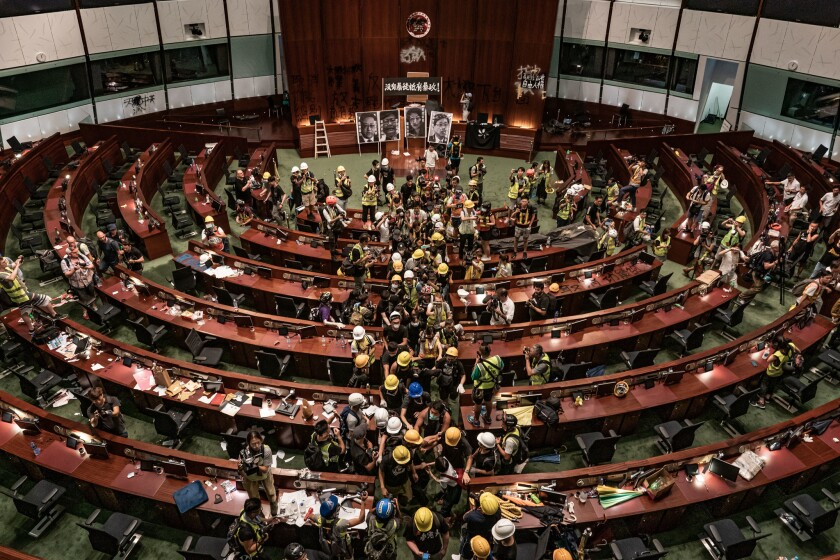 Protesters leave the parliament chamber of the government headquarters on July 1, 2019, in Hong Kong. Thousands of pro-democracy protesters faced off with riot police on July 1, during the 22nd anniversary of Hong Kong's return to Chinese rule.