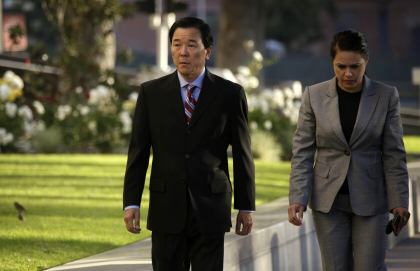 Paul Tanaka, left, arrives at Federal Court in Los Angeles, where the former second in command to former L.A. County Sheriff Lee Baca is charged with conspiracy and obstruction of justice.