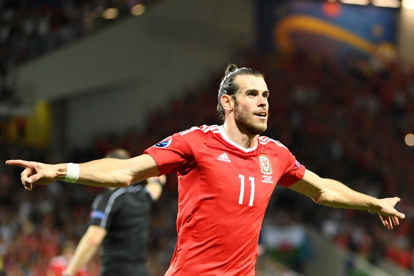 Wales forward Gareth Bale celebrates scoring the team's third goal during a Euro 2016 group B match against Russia.