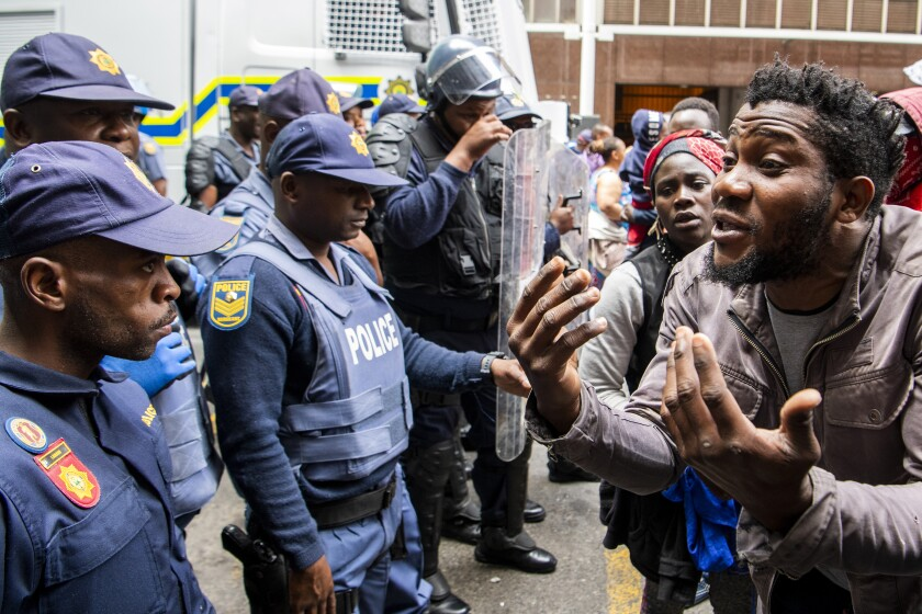 Police clash with protesters outside the U.N. refugee agency's offices in Cape Town, South Africa, on Oct. 30.