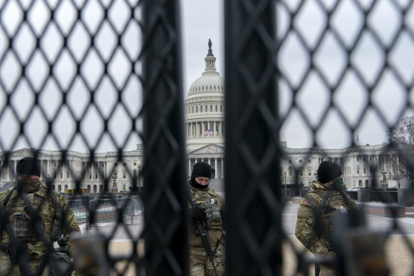 Members of the National Guard patrol the area outside of the U.S. Capitol during the impeachment trial of former President Donald Trump at the Capitol in Washington, Friday, Feb. 12, 2021. (AP Photo/Jose Luis Magana)