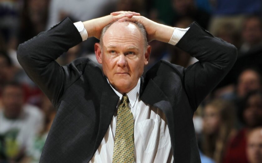 The Denver Nuggets fired coach George Karl last summer after a 57-win season.