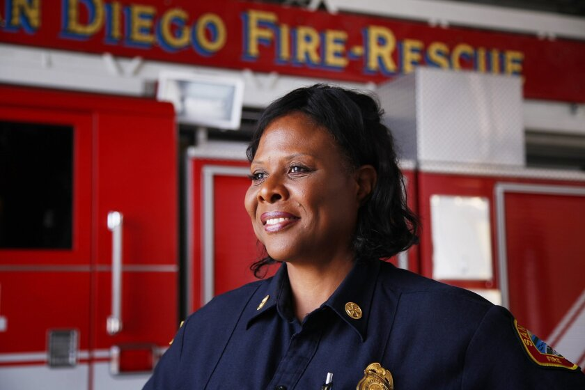 San Diego Fire-Rescue Deputy Chief Lorraine Hutchinson is the Susan G. Komen Foundation's 2014 Honorary Breast Cancer Survivor. She is shown here at Station 14 in North Park.