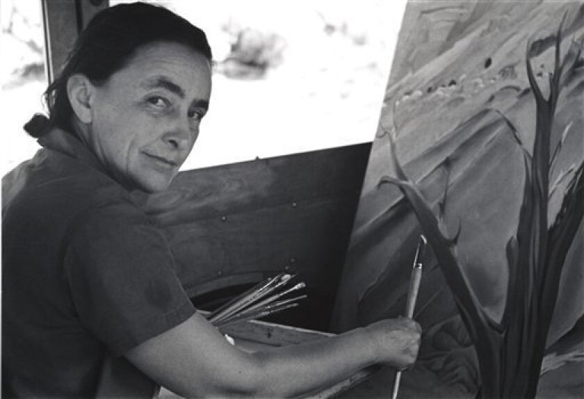 This 1937 image shows American modernist Georgia O'Keeffe painting in her car at Ghost Ranch, N.M.