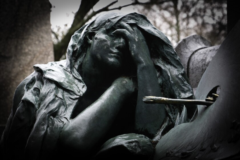 "A detail of a bronze female figure sculpted by Marius Mercié and representing grief (""La Douleur"") is part of the tomb of artist Paul Baudry."