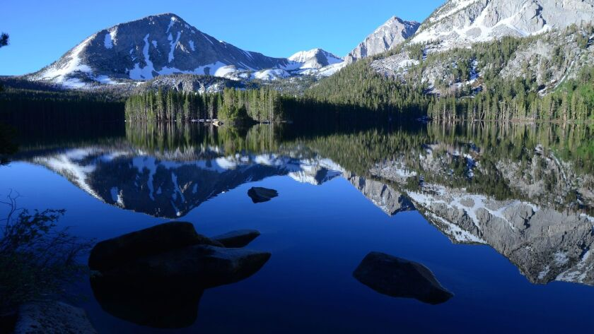 Lake Davis and surrounding mountains on a morning without wind in the Eastern Sierra. Come hear writer and photographer Christopher Reynolds' tips on how to create the best digital travel memories.