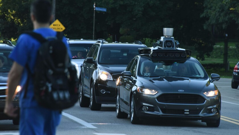 A fleet of Uber's self-driving cars in Pittsburgh.