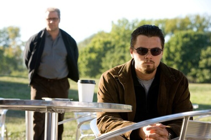 "A-LISTERS: Russell Crowe, left, and Leonardo DiCaprio in ""Body of Lies."" Some tracking surveys estimate that the film will take in $13 million to $19 million in its opening weekend."