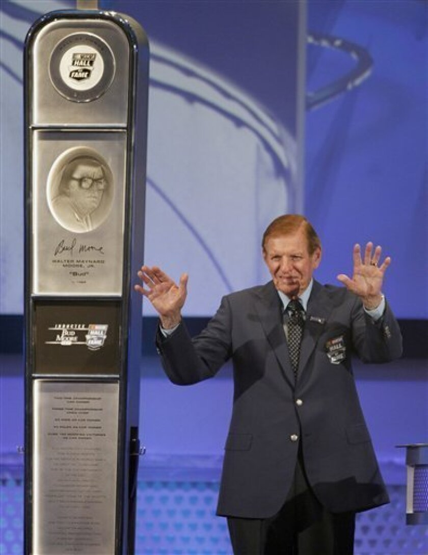 Bud Moore acknowledges the crowd after being inducted into the NASCAR Hall of Fame during a ceremony in Charlotte, N.C., Monday, May 23, 2011. (AP Photo/Terry Renna)