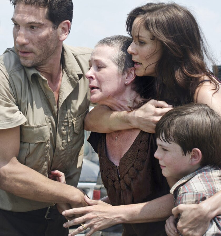 "AMC's zombie drama ""The Walking Dead"" ranks as the most social TV show on Twitter this week, according to Nielsen. Actors shown are Jon Bernthal, left, Melissa Suzanne McBride, Sarah Wayne Callies and Chandler Riggs."