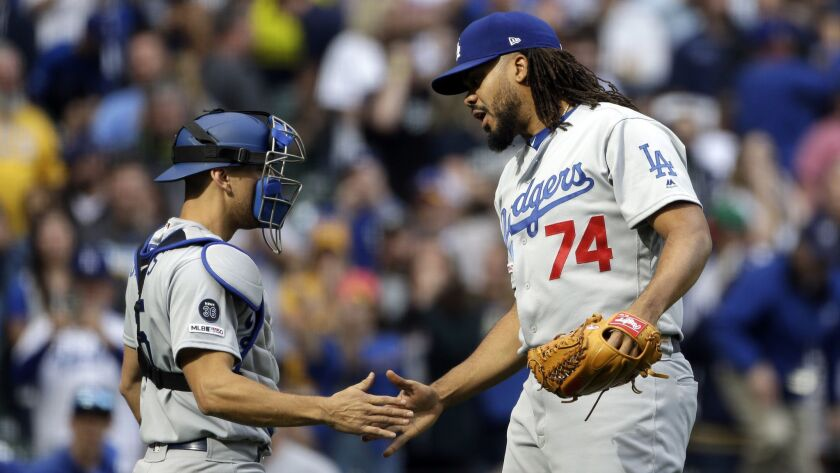 Dodgers closer Kenley Jansen is congratulated by catcher Austin Barnes after a 6-5 win over the Milwaukee Brewers on April 21.