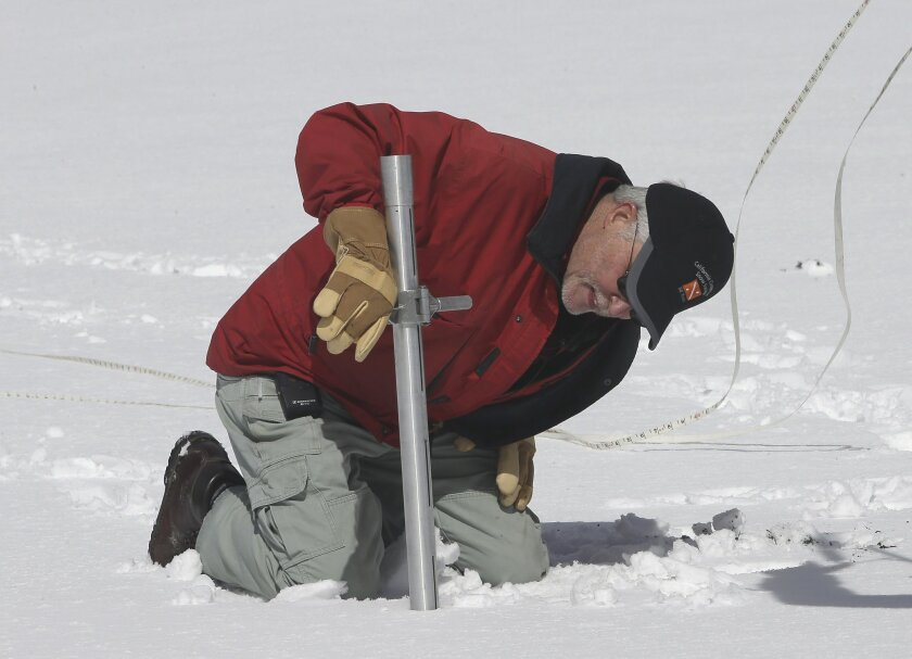 Frank Gehrke, chief of the California Cooperative Snow Surveys Program for the Department of Water Resources, checked the snowpack depth near Echo Summit on March 30, 2016. El Nino has brought more rain and snow to Northern California than last year, but the state's drought remains. / photo by Associated Press